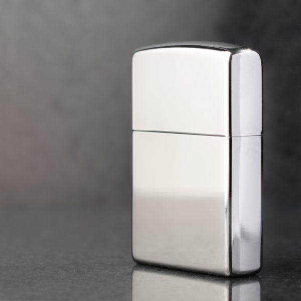 Polished Silver Zippo Lighter.